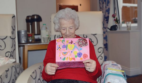 copy-of-mary-reed-reading-a-valentine_s-day-card-made-by-children-from-wroxham-school